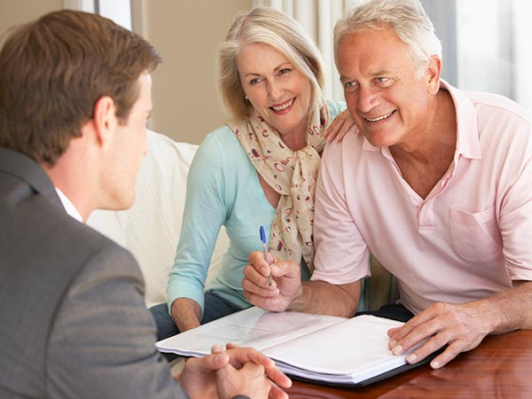 A couple works with an Estate Planning Attorney